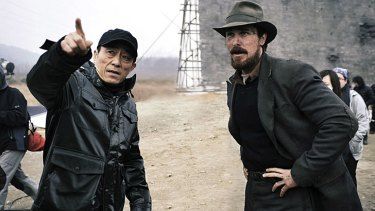Zhang (left) with Christian Bale on the set of <i>The Flowers of War</i>.