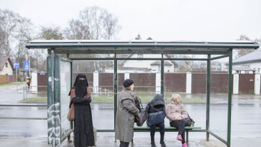 Liga Legzdina waits for a bus in a suburb of Riga this month.