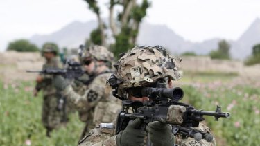 A US soldier from 82nd Airborne on patrol with Afghan National Army soldiers.