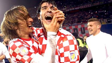 Luka Modric (L) and Vedran Corluka of Croatia celebrate after qualifying for the World Cup.