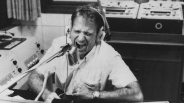 Robin Williams as Adrian Cronauer in a scene from <i>Good Morning Vietnam</i>.