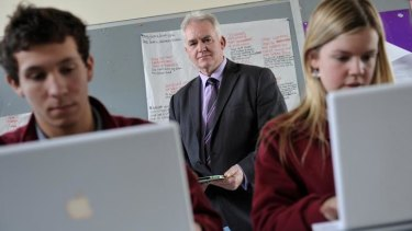 Ringwood Secondary College principal Michael Phillips, with students Dylan Hornsby and Kirsty Gayther, believes students should use computers in their VCE exams.
