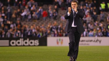 Hot property: Ange Postecoglou leaves the field after his final game with Victory.