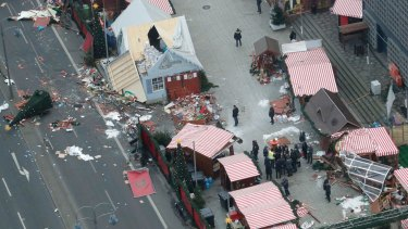 German Chancellor Angela Merkel and other government members visit the site of the attack in Berlin.