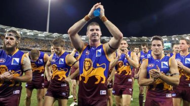 Jonathan Brown leads his Brisbane team off the Gabba after their season opening victory over the West Coast Eagles.
