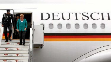 German Chancellor Angela Merkel disembarks from at Belfast International airport in Belfast, Northern Ireland, to attend the G8 summit at the Lough Erne resort.
