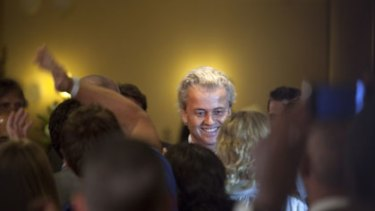 Big gains ... the leader of the Party for Freedom, Geert Wilders, greets supporters on election night in The Hague. Mr Wilders is due in court later this year to face charges of inciting racism.