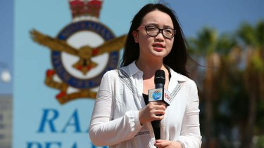 A China News Corporation reporter outside RAAF base Pearce in Perth.