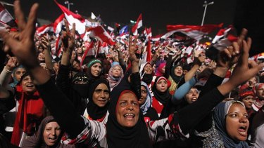 Protesters in Tahrir Square celebrate after the military coup.
