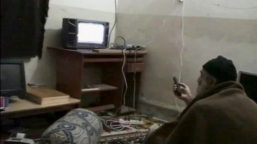 Osama bin Laden watching himself on television in a US Department of Defence video.