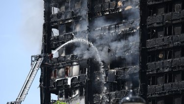 Fire fighters toil fruitlessly to quell the flames in the 24-storey Grenfell Tower in  West London.