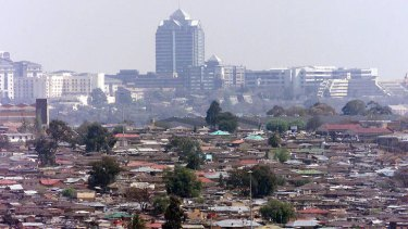 Alexandra township is overshadowed by the Sandton skyscrapers of Johannesburg.