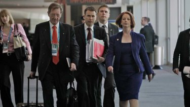 Salary hikes ... Prime Minister Julia Gillard with the head of her department Dr Ian Watt, left, will receive significant raises.
