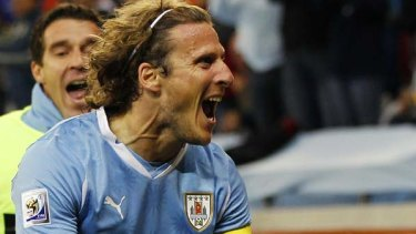 Injured ... Diego Forlan scored, but it wasn't enough.