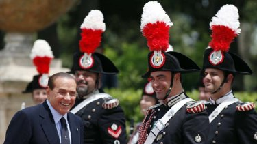 Ever defiant ... Silvio Berlusconi at a military parade in Rome on Thursday.