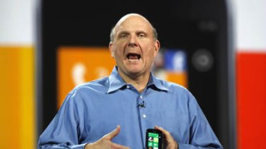 Microsoft CEO Steve Ballmer holds a Windows 7 phone during his keynote address on the eve of the Consumer Electronics Show in Las Vegas.
