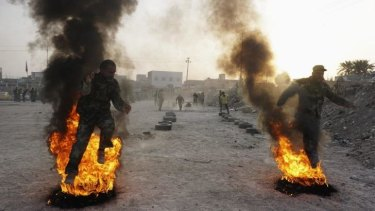 Sectarian fires: Shiite volunteers for the Iraqi army undergo training in the southern Iraqi city of Najaf.