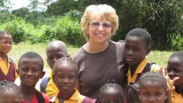 Nancy Writebol, with children in Liberia,l is one of two Americans working for a missionary group in Liberia that have been diagnosed with Ebola.