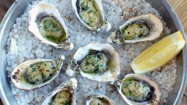 Oysters baked in their shells.