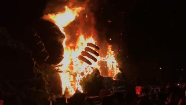 Footage shows the giant gorilla statue going up in flames at the Vietnamese movie premiere.