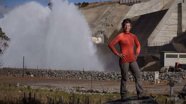 Happy returns: Acacia Rose of the activist group the Snowy Rover Alliance at the Jindabyne dam at the time of a scheduled release to the Snowy River.