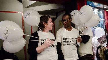 Campaign volunteers for Emmanuel Macron before the start of a campaign event in Paris.