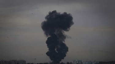 Smoke billows over the outskirts of Benghazi, eastern Libya, after a warplane was shot down Saturday.