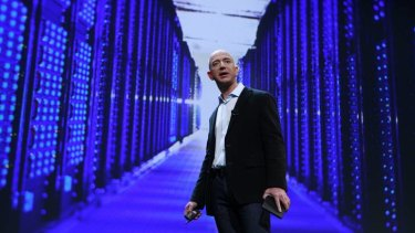 Amazon CEO Jeff Bezos launching Amazon's tablets last year. The company wants to hire more engineers for its operations in Seattle.