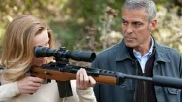 George Clooney (right) can't sell himself as a cool, cold-hearted killer in the flat thriller The American.