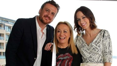 Making the cut ...  co-stars Jason Segal, Jacki Weaver and Emily Blunt celebrate <em>The Five-Year Engagement</em> with a slice of wedding cake.