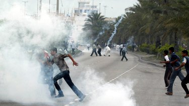 Rioters flee during the Arab Spring protests in Bahrain.