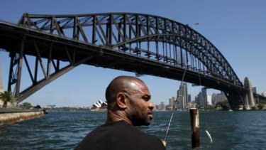 Gone fishin' . . . American boxing great Roy Jones jnr takes time out from training to wet a line on the harbour yesterday. Come Wednesday, he'll have bigger fish to fry when he meets Danny Green in the ring.
