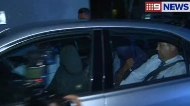 The 25-year-old arrives at the Brisbane Watchhouse on Tuesday night.