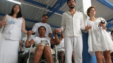A wheelchair-bound patient waits to see Joao de Deus.