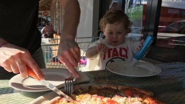 #4: Little Edith P enjoying a slices of Amica Cafe pizza.