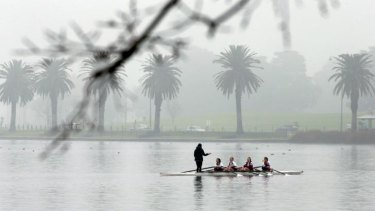 All weather friend: A deep fog doesn't deter rowers on Albert Lake.