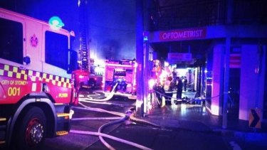 A fire has destroyed a convenience store in Rozelle.