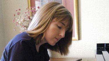Hillary Adams practises the piano in this March 2005 photo.