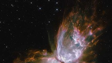 A butterfly emerges from as a star dies in Planetary Nebula NGC 6302.