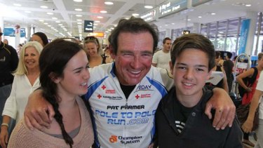 Pat Farmer is reunited with his family at Sydney Airport yesterday.