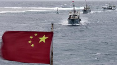 Chinese fishing boats sail in the lagoon of Meiji reef off the island province of Hainan in the South China Sea.