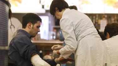 Paramedics provide help to a passenger at Moskovsky train station.