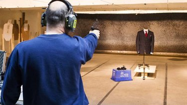 Extra protection: A marksman shoots a handgun at the bulletproof suit.