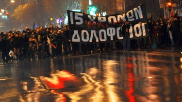 Greek leftist protestors march during a peaceful demonstration in the northern Greek city of Thessaloniki.