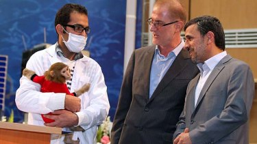 Rocket man ... President Mahmoud Ahmadinejad, right, catches up with Pishgam the space monkey.