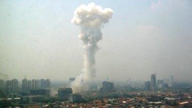 Smoke billows following a blast outside the Australian embassy in Jakarta on September 9, 2004.
