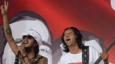 Supporters of Joko Widodo perform on stage at the Jokowi Center in Jakarta on Wednesday.