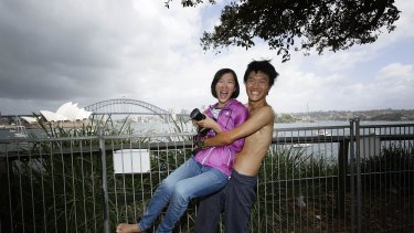 Cheng-Yen Chen and his sister Wer Yu Chen from Tiawan where the first people to queue and camp out at the Domain to get a prime position at Lady Macquaries Chair, on December 31, 2014 in Sydney, Australia. Cheng- Yen had been camped out at the Domain since 5pm on Monday.
