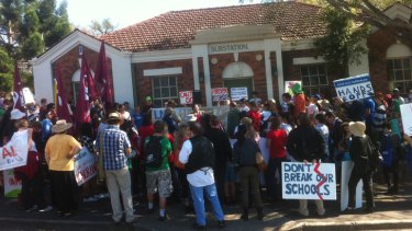About 200 people gather at Bowen Hills close to Sunday's LNP 2013 Convention to protest the closure of eight schools in southeast Queensland.