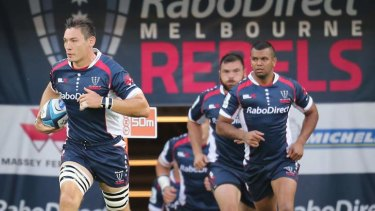 Gareth Delve leads the Rebels out on the field.